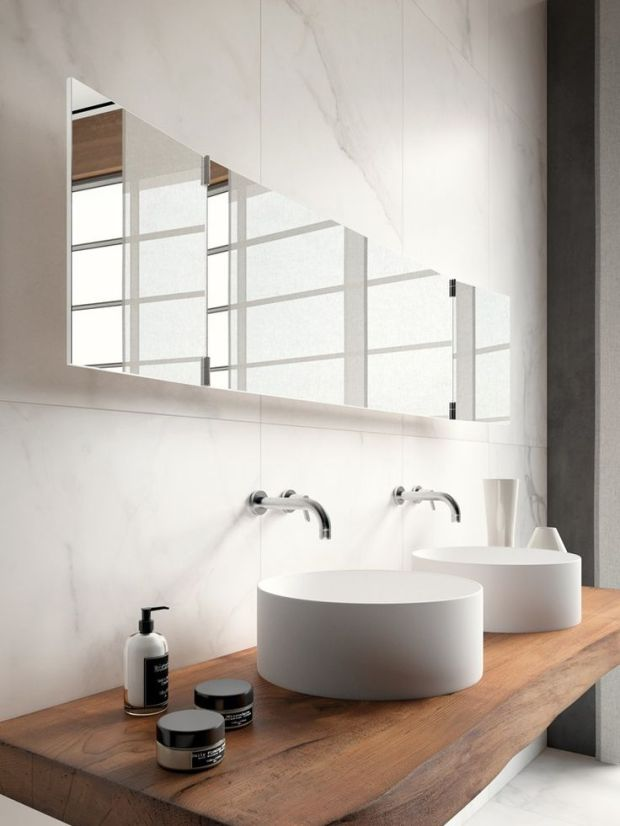 white modern bath with wood counters and floating mirror