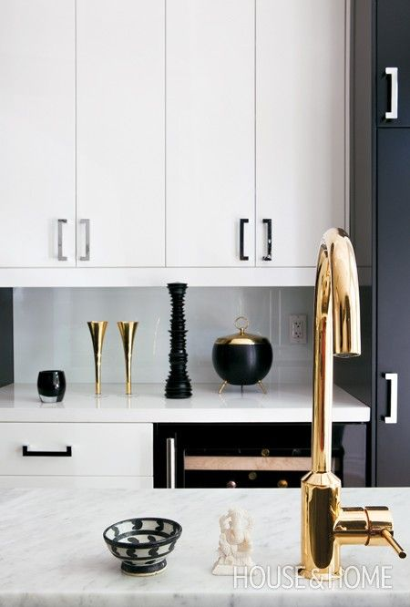 black and white kitchen with brass and chrome accents
